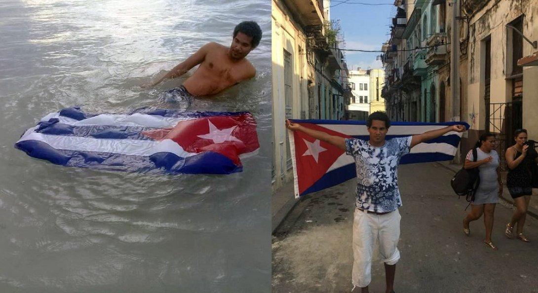 "El artista Otero Alcántara con la bandera cubana. Performance Performance ""Le Drapeau"" 1"